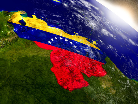 Venezuela with embedded flag on planet surface during sunrise. 3D illustration with highly detailed realistic planet surface and visible city lights. Elements of this image furnished by NASA.