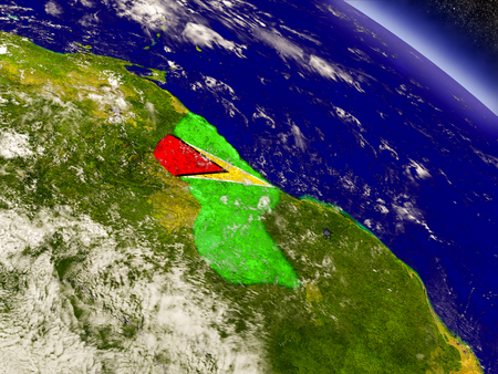 Flag of Guyana on planet surface from space. 3D illustration with highly detailed realistic planet surface and clouds in the atmosphere. Stock Photo