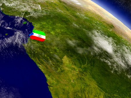 Flag of Equatorial Guinea on planet surface from space. 3D illustration with highly detailed realistic planet surface and clouds in the atmosphere.