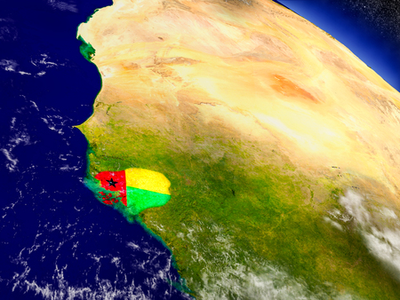 Flag of Guinea-Bissau on planet surface from space. 3D illustration with highly detailed realistic planet surface and clouds in the atmosphere.