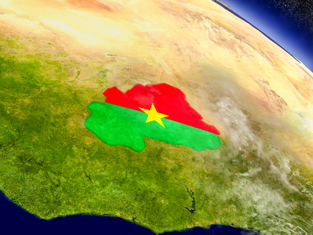 Flag of Burkina Faso on planet surface from space. 3D illustration with highly detailed realistic planet surface and clouds in the atmosphere. Stock Photo