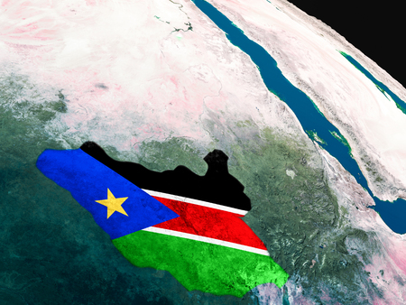 South Sudan with embedded national flag as if seen from Earths orbit in space. 3D illustration with highly detailed realistic planet surface. Stock Photo