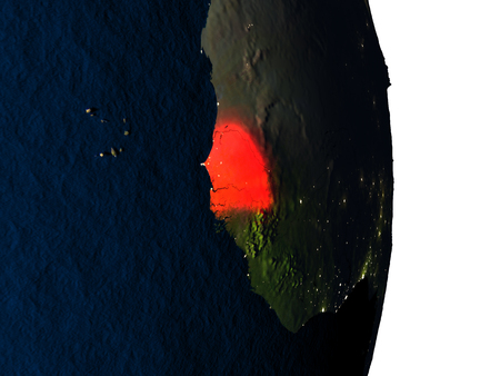 Dusk over Senegal highlighted in red with city lights as seen from Earths orbit in space. 3D illustration with highly detailed realistic planet surface.