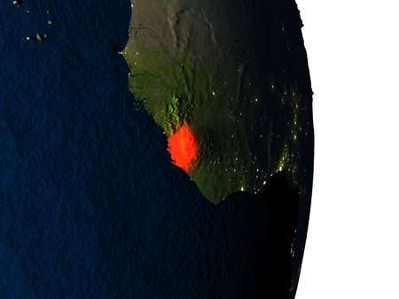 Dusk over Sierra Leone highlighted in red with city lights as seen from Earths orbit in space. 3D illustration with highly detailed realistic planet surface.