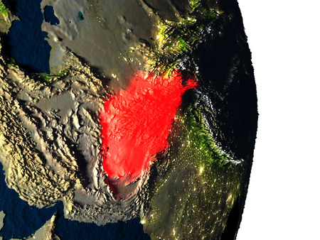 Dusk over Afghanistan highlighted in red with city lights as seen from Earths orbit in space. 3D illustration with highly detailed realistic planet surface. Stock Photo