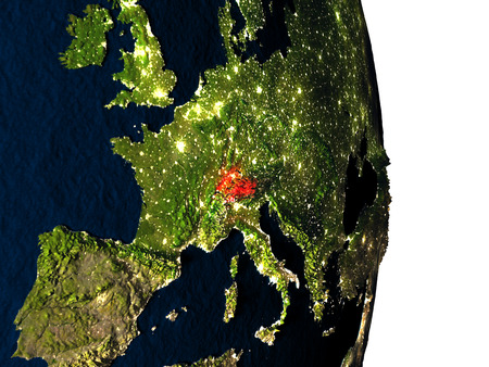 Dusk over Switzerland highlighted in red with city lights as seen from Earths orbit in space. 3D illustration with highly detailed realistic planet surface. Stock Photo