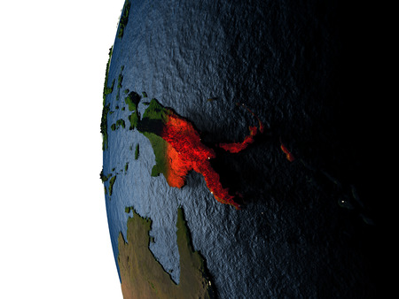 Papua New Guinea highlighted in red on Earth as seen from Earths orbit in space during sunset. 3D illustration with highly detailed realistic planet surface. Stock Photo