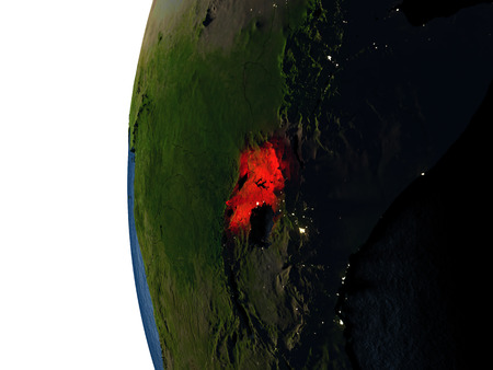 Uganda highlighted in red on Earth as seen from Earths orbit in space during sunset. 3D illustration with highly detailed realistic planet surface. Stock Photo