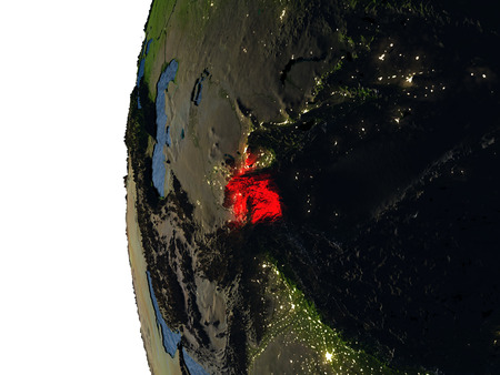 Tajikistan highlighted in red on Earth as seen from Earths orbit in space during sunset. 3D illustration with highly detailed realistic planet surface.