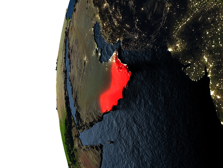 Oman highlighted in red on Earth as seen from Earths orbit in space during sunset. 3D illustration with highly detailed realistic planet surface.