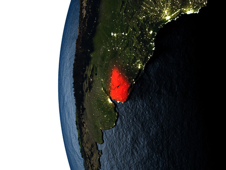 Uruguay highlighted in red on Earth as seen from Earths orbit in space during sunset. 3D illustration with highly detailed realistic planet surface. Stock Photo