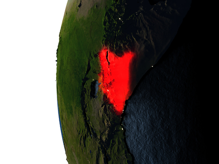 Kenya highlighted in red on Earth as seen from Earths orbit in space during sunset. 3D illustration with highly detailed realistic planet surface. Stock Photo