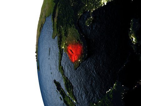 Cambodia highlighted in red on Earth as seen from Earths orbit in space during sunset. 3D illustration with highly detailed realistic planet surface. Stock Photo