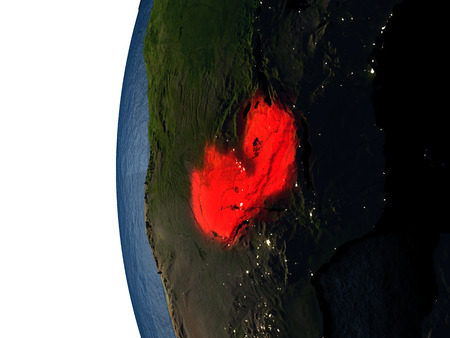 Zambia highlighted in red on Earth as seen from Earths orbit in space during sunset. 3D illustration with highly detailed realistic planet surface. Stock Photo