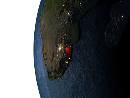 Swaziland highlighted in red on Earth as seen from Earths orbit in space during sunset. 3D illustration with highly detailed realistic planet surface.