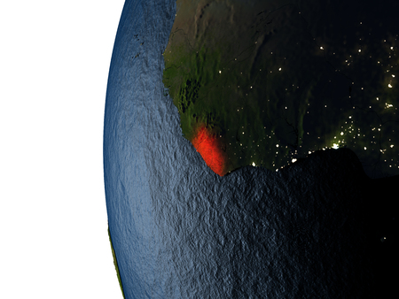 Liberia highlighted in red on Earth as seen from Earths orbit in space during sunset. 3D illustration with highly detailed realistic planet surface. Stock Photo