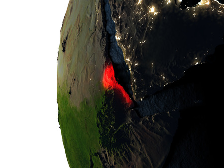 Eritrea highlighted in red on Earth as seen from Earths orbit in space during sunset. 3D illustration with highly detailed realistic planet surface.
