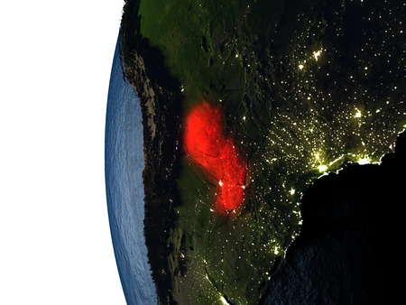 Paraguay highlighted in red on Earth as seen from Earths orbit in space during sunset. 3D illustration with highly detailed realistic planet surface. Stock Photo