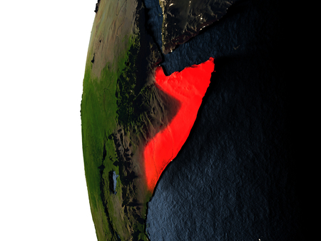 Somalia highlighted in red on Earth as seen from Earths orbit in space during sunset. 3D illustration with highly detailed realistic planet surface. Stock Photo