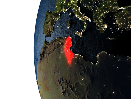 Tunisia highlighted in red on Earth as seen from Earths orbit in space during sunset. 3D illustration with highly detailed realistic planet surface.