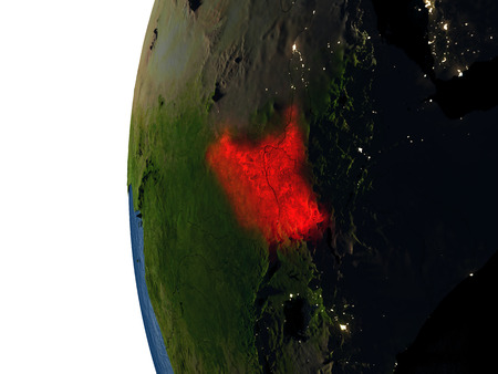 South Sudan highlighted in red on Earth as seen from Earths orbit in space during sunset. 3D illustration with highly detailed realistic planet surface.