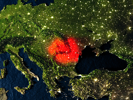 Romania in red at night as seen from Earths orbit in space. 3D illustration with highly detailed realistic planet surface. Elements of this image furnished by NASA. Stock Photo