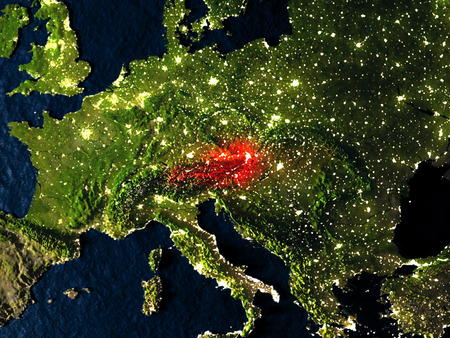 Austria in red at night as seen from Earths orbit in space. 3D illustration with highly detailed realistic planet surface. Elements of this image furnished by NASA.
