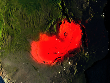 Zambia in red at night as seen from Earths orbit in space. 3D illustration with highly detailed realistic planet surface. Elements of this image furnished by NASA. Stock Photo