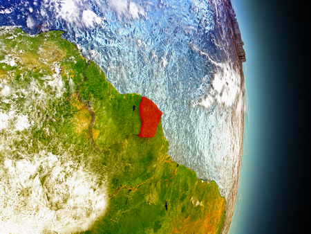 guiana: Model of French Guiana from Earths orbit in space. 3D illustration with highly detailed realistic planet surface and clouds in the atmosphere. Stock Photo