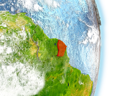 French Guiana in red on model of planet Earth. 3D illustration with highly detailed realistic planet surface and clouds.