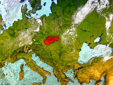 Slovakia highlighted in red on illustrated globe with realistic ocean waters and clouds as seen from Earths orbit in space. 3D illustration with high level of detail. Stock Photo