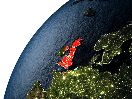 visible: United Kingdom highlighted in red on planet Earth with visible city lights. 3D illutration with detailed planet surface. Stock Photo