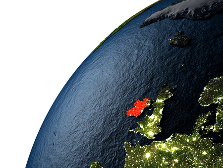 Ireland highlighted in red on planet Earth with visible city lights. 3D illutration with detailed planet surface. Stock Photo