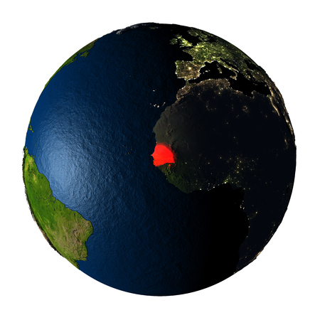 Senegal highlighted red on highly detailed model of planet Earth with visible city lights, plastic oceans and mountain ranges. 3D illustration isolated on white background. Stock Photo