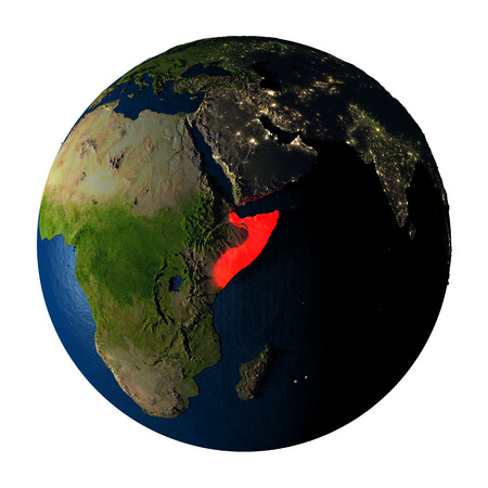 Somalia highlighted red on highly detailed model of planet Earth with visible city lights, plastic oceans and mountain ranges. 3D illustration isolated on white background. Stock Photo