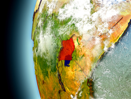 Uganda on model of Earth with watery oceans and realistic clouds in the atmosphere. 3D illustration with detailed planet surface. Stock Photo