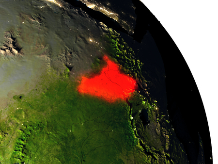 South Sudan highlighted in red on model of planet Earth with very detailed land surface and visible city lights. 3D illustration.