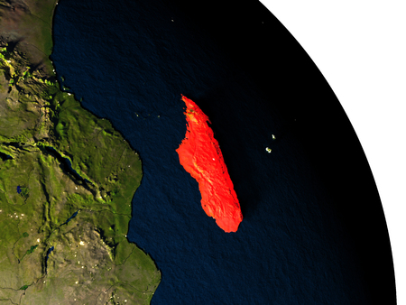 Madagascar highlighted in red on model of planet Earth with very detailed land surface and visible city lights. 3D illustration.