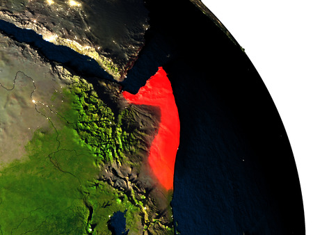Somalia highlighted in red on model of planet Earth with very detailed land surface and visible city lights. 3D illustration.