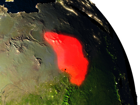 Chad highlighted in red on model of planet Earth with very detailed land surface and visible city lights. 3D illustration.