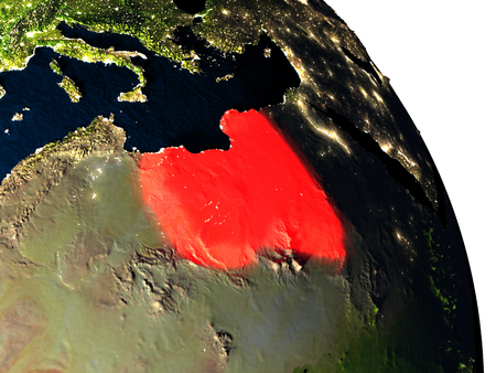 Libya highlighted in red on model of planet Earth with very detailed land surface and visible city lights. 3D illustration. Stock Photo