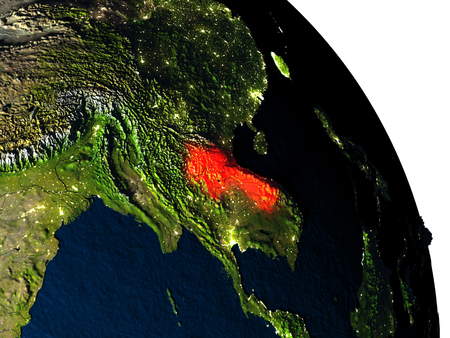Laos highlighted in red on model of planet Earth with very detailed land surface and visible city lights. 3D illustration.
