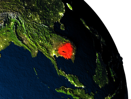 cambodian: Cambodia highlighted in red on model of planet Earth with very detailed land surface and visible city lights. 3D illustration. Stock Photo