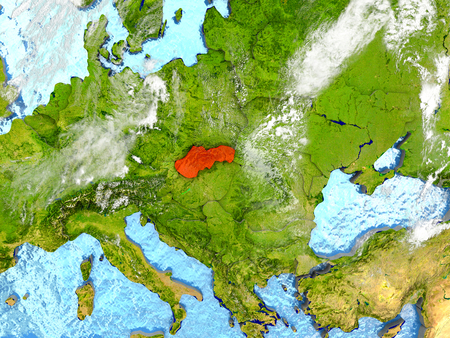 Slovakia in red on map with detailed landmass texture, realistic watery oceans and clouds above the surface. 3D illustration. Stock Photo