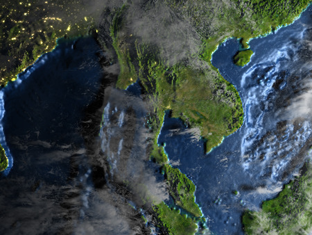 Indochina on 3D model of Earth at night. 3D illustration with plastic planet surface and ocean floor and visible city lights. Stock Photo