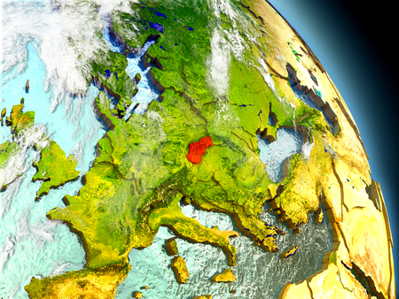 Slovakia in red on model of planet Earth with embossed countries and visible country borders. 3D illustration with clouds and reflective ocean waters. Stock Photo
