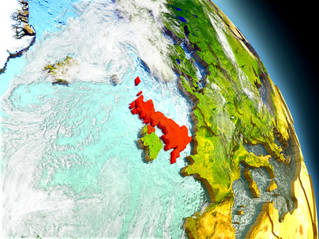 visible: United Kingdom in red on model of planet Earth with embossed countries and visible country borders. 3D illustration with clouds and reflective ocean waters. Stock Photo