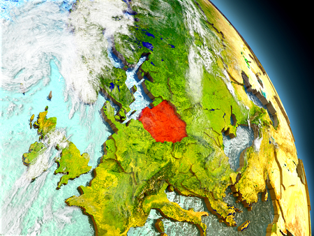 visible: Poland in red on model of planet Earth with embossed countries and visible country borders. 3D illustration with clouds and reflective ocean waters.