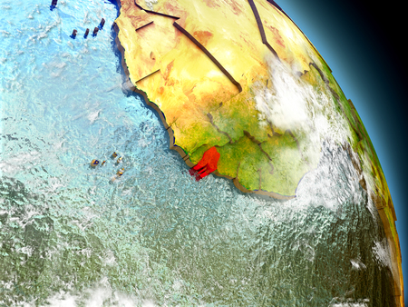 Guinea-Bissau in red on model of planet Earth with embossed countries and visible country borders. 3D illustration with clouds and reflective ocean waters.