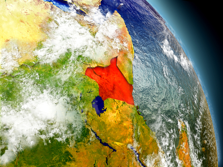Kenya in red on model of planet Earth with embossed countries and visible country borders. 3D illustration with clouds and reflective ocean waters.